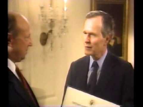 President Bush SR presents NFL Commissionair Pete Rozelle with a charity works award