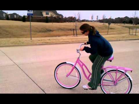 Shana riding her new pink schwinn cruiser bike