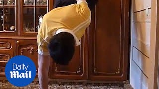 Incredible moment man does push ups with only two fingers!