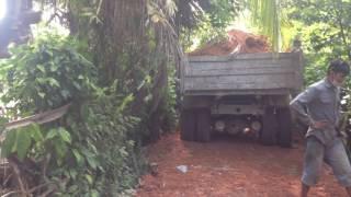 Red laterite to small village roadចាក់ដីក្រហមតាមផ្លូវភូមិតូចៗ