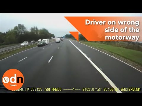 Shocking footage shows driver on wrong side of the motorway