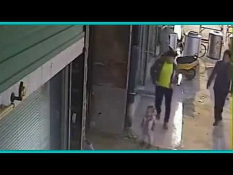 Caught On Camera: Chinese Man Throws a 1 Year Old Boy Across Street!