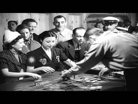 Passengers play Casino Roulette game aboard a gambling ship underway off the coas...HD Stock Footage