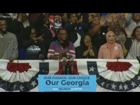 Rep. John Lewis takes stage at rally for Democrat Stacey Abrams