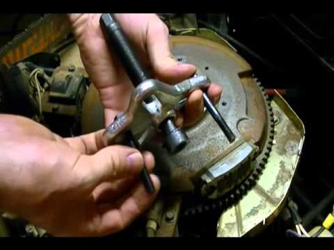 remove  flywheel   pulley puller  older briggs funnydogtv