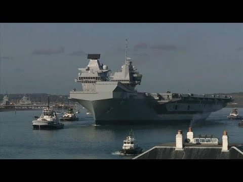 HMS Queen Elizabeth: Britain's biggest aircraft carrier commissioned into service