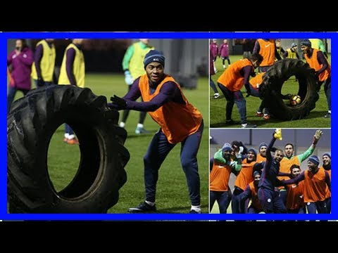 Manchester city stars enjoy training session with a giant tractor tyre as they prepare for premier
