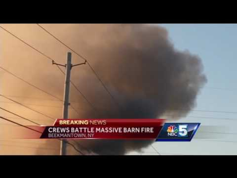 Crews battle massive barn fire in Beekmantown