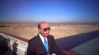 الفريق مميش على سطح أعلى حاملة حاويات فى العالم مع القنصل الصينى خلال مرورها بقناة السويس