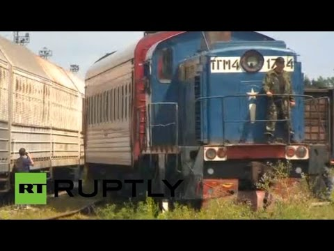 Train carrying remains of MH17 crash victims arrives in Kharkov, Ukraine