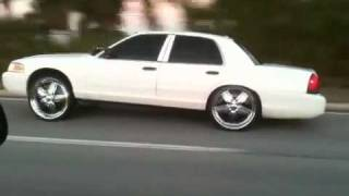 "Crown Vic bagged on 24"" DUB Padrones"