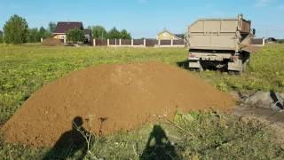 видео доставка песка камазом