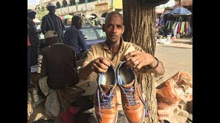 Getting my Shoes done in Banjul / Gambia