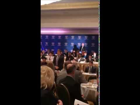 Mr. Archie Manning awarding Andrew Genois at 2014 National Football Foundation Awards Luncheon