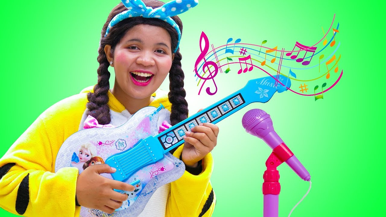 Johny Plays with Disney Frozen Toy Guitar and Starts a Band