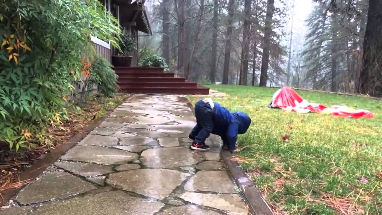 Image result for baby playing on rain