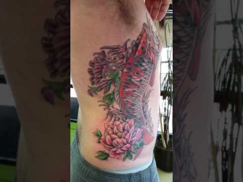 Koi Fish And Lotus Flower Tattoo By Jeffrey Ziozios At Bay City Tattoos In Tampa Florida