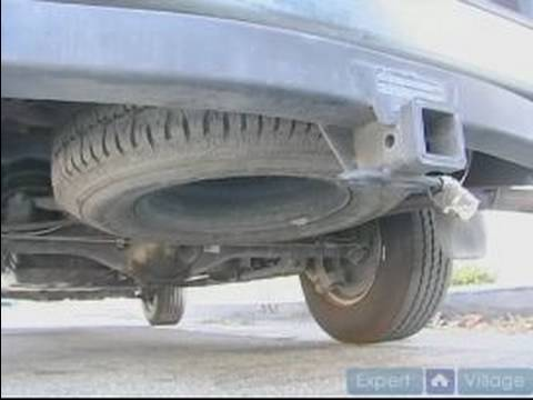 How to Change A Flat Tire : How To Remove A Spare Tire