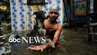 Flooding in India, surfing competition, Afghan forces: World in Photos, Aug. 20
