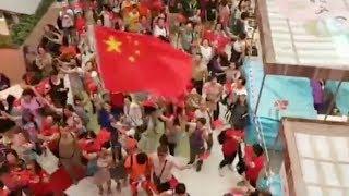 "HK residents sing Chinese national anthem to support HKSAR 第三場""快閃""唱國歌活動在淘大花園舉行"