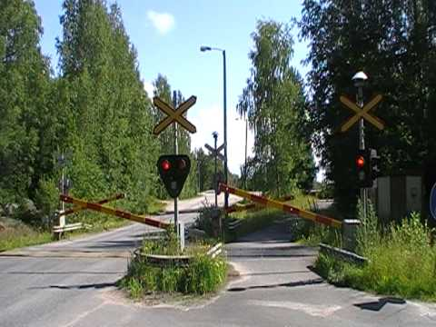 Finnish freight train 1543 passed Eerola level crossing