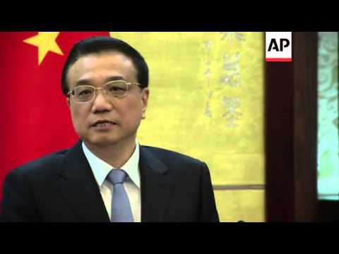 Chinese Premiere meets French PM; pay tribute to Mandela