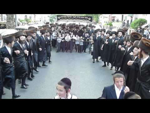 Belz Chasidim Dancing in Streets of Boro Park with Sifrei Torahs, Moving to new Shteebel