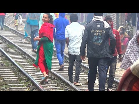 peoples walking on Rail line / Rail route in Dhaka / BR