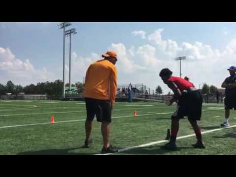 Tennessee assistant Robert Gillespie puts backs through a drill at Buford High School in Georgia on