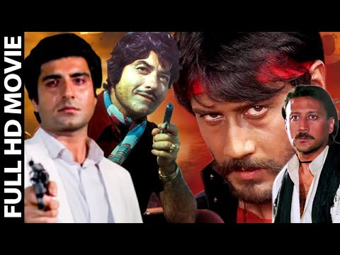 God And Gun - Full Hindi Bollywood Action Movie HD - Raaj Kumar, Jackie Shroff, Gautami: God and Gun is a film on contemporary events A daringly different film. It bringsforth authentically the inside realities of today's politics. God and Gun advocates the truth that power lies in the hands of people and not politicians. The voice of the people is the voice of god.  Corrupt politician Satya Singh is all set to win this year's election also - by hook or by crook. The only person opposing him is Saheb Bahadur Rathore. Satya finds out that Rathore's following is getting stronger, and he sets about attempting to discredit him, in vain. Meanwhile, fed-up of cosmetic elections, corrupt policitians, a young man, Vijay Prakash, has set up his own code to deal with corrupt politicians like Satya - kill them. One day Vijay saves Rathore's life, and both become friends. But with so many differences in their way of operating, will they continue to be friends, or are they part of Satya's new ploy?  Starring : Raaj Kumar, Jackie Shroff, Gautami Directed by Esmayeel Shroff Produced by Kulbhushan Gupta Written by Moin-ud-din  Action Tadka India:The one stop for the latest on Bollywood, Tollywood, Kollywood, Sandalwood and Mollywood  Upcoming Bollywood Films,South Dubbed,New Released Hindi Movies, Hollwood Dubbed Movies and a host of other Spicy videos  -  Movies  for you to entertain 24 hours. Be it the latest updated movies, free mobile, new song, watching new film, old superhit movie, and all in an endless thread of entertainment in our youtube list. Action Tadka India, free online streaming is just a click away from your mobile, laptop, tablet, desktop and phablet with multiple file formats for all devices. From horror, comedy, family, crime, drama, fantasy, mystery, history, sci-fi, thriller, western to any new trend we have uploaded it all.  Like * Comment * Share  Your One Stop Destination For All The Latest Videos