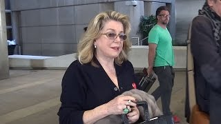 Catherine Deneuve Corrects At LAX: 'I'm Not Married'