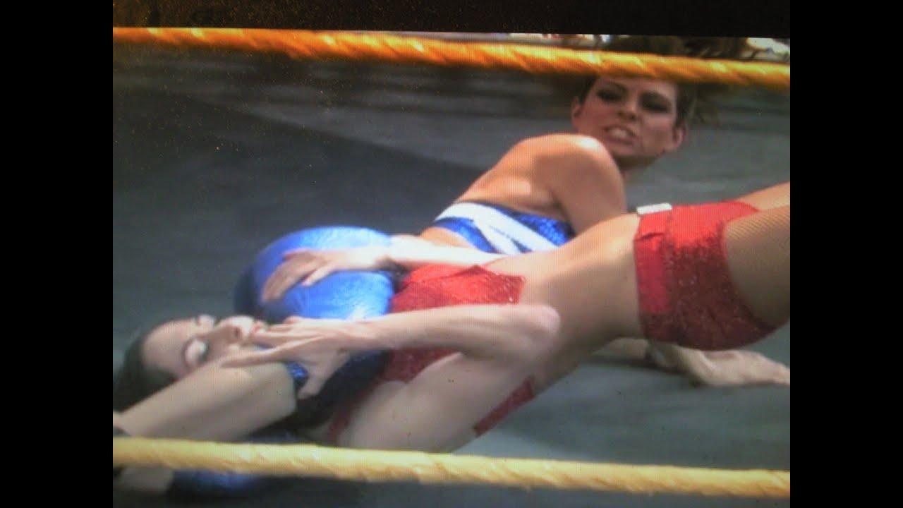 maria menounos wrestles brie bella in ring outside