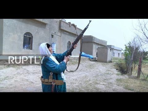 Iraq: Women take up arms to protect village from IS militants