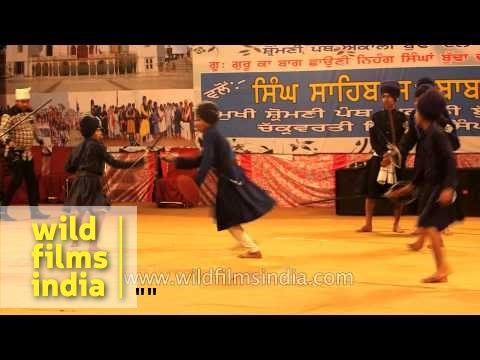 Young Nihang trainees perform Gatka martial arts, Punjab