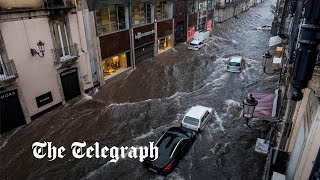 'It's chaos': restaurant owner films floods tearing through Sicily