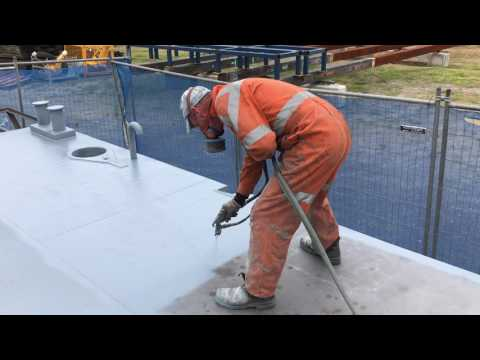 Painting steel barge