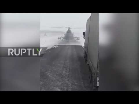 Kazakhstan: Military helicopter stops to ask for directions on road near Karabutak
