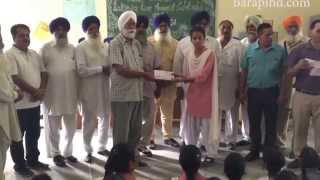 Giving Scholarship  to the students of Govt. Girls Sen. Sec. School Bara Pind
