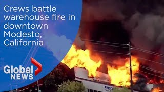 Crews battle warehouse fire in downtown Modesto, California