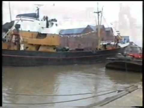 Arctic Corsair H320 being towed down the River Hull and docked.