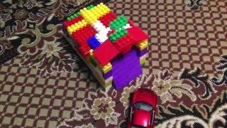 как сделать из конструктора гараж с открывающийся дверью
