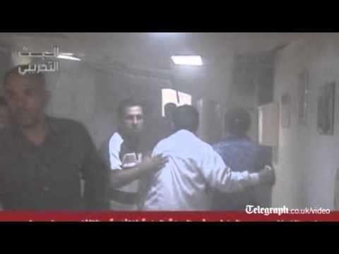 Syria blast: scene from inside State TV building in Damascus