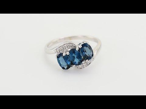 6a21100a8ba Zlatý prsten s modrými oválnými topazy ...