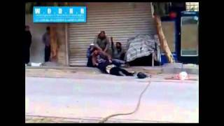 Syria,Zabadani-The men are trying to retrieve the body of an Iraqi lady shatha Kabsi 14/12/2011