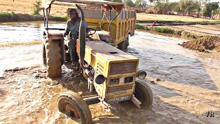 HMT 3522 tractor with full loaded trolley stuck in mud strugling in mud