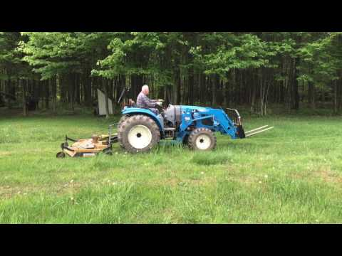 LS 4040 Tractor Mowing Heavy Grass