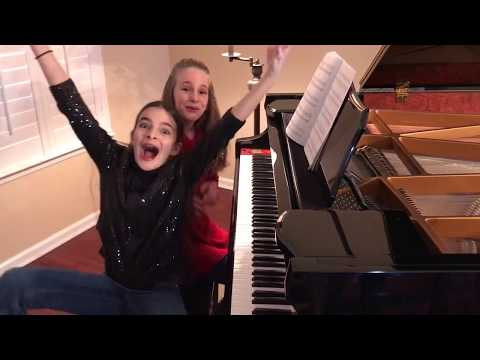 Ukrainian Carol of the Bells, pre-teen piano duet, amazing!  Please share