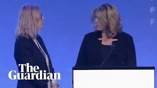 Demonstrator ambushes Penny Mordaunt on stage during aid abuse speech