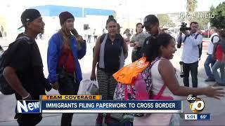 Migrants get paperwork in order ahead of caravan