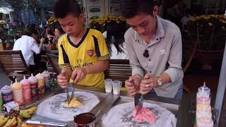 Two boys make a very nice and professional Ice Cream Roll in Hoi An